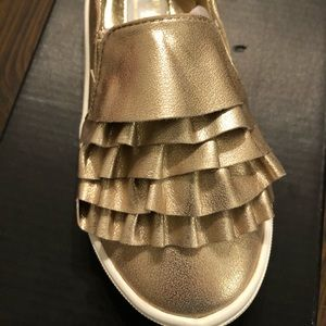 Kenneth Cole gold toddler shoes.